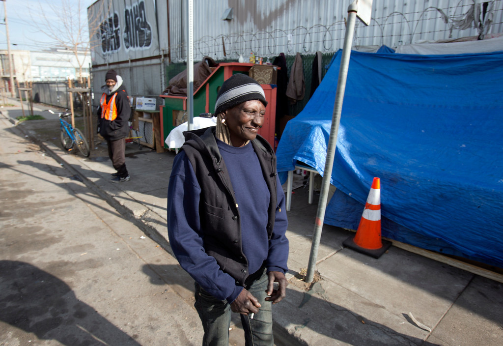 """. \""""Wonder,\"""" a homeless woman who now lives in the shelter built for her by Greg Kloehn, stands near her place on the streets of west Oakland, Calif., Tuesday, Dec. 31, 2013. (D. Ross Cameron/Bay Area News Group)"""