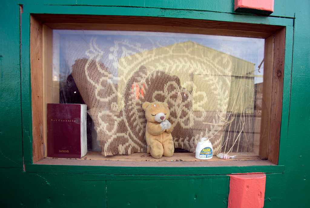 """. A \""""prayer bear\"""" sits in the window of a rolling shelter occupied by \""""Wonder,\"""" a homeless woman who once lived under just a discarded couch with a tarp thrown over it, photographed Tuesday, Dec. 31, 2013. (D. Ross Cameron/Bay Area News Group)"""