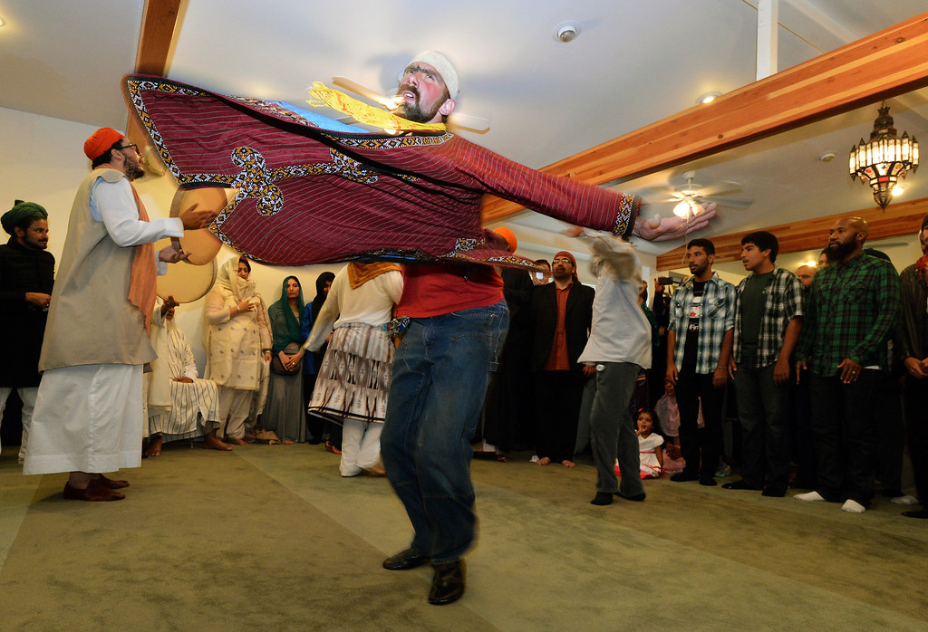 . Men dance and play drums during an Eid al-Fitr celebration at the Naqshbandi Sufi Order Masjid Al Iman mosque in Oakland, Calif., on Thursday, Aug. 8, 2013. Muslims worldwide recognize the conclusion of Ramadan with Eid al-Fitr celebrations. (Kristopher Skinner/Bay Area News Group)