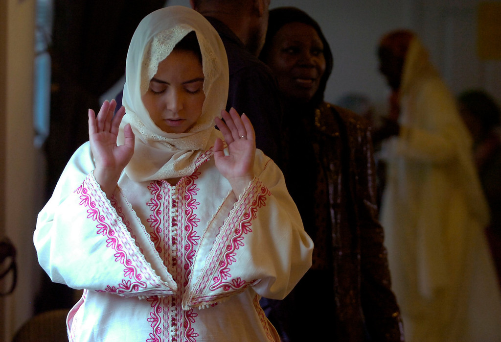. Ismahan Mazouni, of Berkeley, prays during an Eid al-Fitr celebration at the Naqshbandi Sufi Order Masjid Al Iman mosque in Oakland, Calif. on Thursday, Aug. 8, 2013. Muslims worldwide recognize the conclusion of Ramadan with Eid al-Fitr celebrations. (Kristopher Skinner/Bay Area News Group)