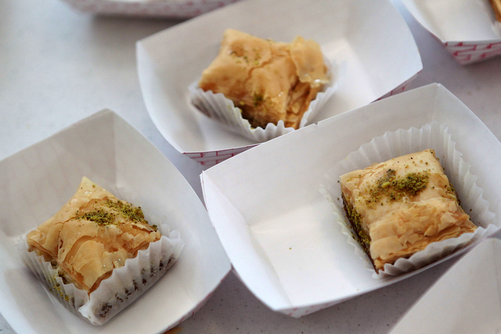 . Baklava is served during a celebration of Eid al-Fitr at the Silliman Center in Newark, Calif., on Thursday, Aug. 8, 2013. (Anda Chu/Bay Area News Group)