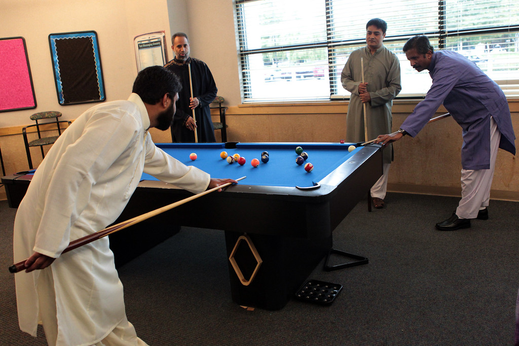 . Men play a game of pocket billiards during an  Eid al-Fitr celebration at the Silliman Center in Newark, Calif., on Thursday, Aug. 8, 2013. (Anda Chu/Bay Area News Group)