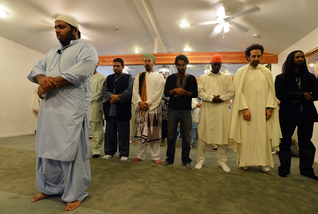 . Lisan Ansari, left, leads a traditional prayer during an Eid al-Fitr celebration at the Naqshbandi Sufi Order Masjid Al Iman mosque in Oakland, Calif., on Thursday, Aug. 8, 2013. (Kristopher Skinner/Bay Area News Group)