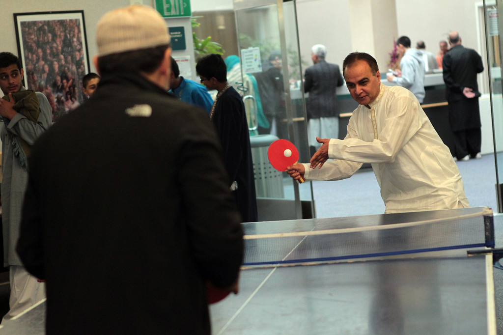 . Ayman Alfarra and Faheem Khan, from left, both of Fremont, play a game of table tennis during an  Eid al-Fitr celebration at the Silliman Center in Newark, Calif., on Thursday, Aug. 8, 2013. (Anda Chu/Bay Area News Group)