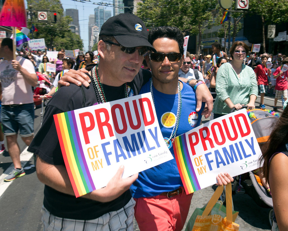 . Bob Garrison, left, and Ion Vergaras, of Berkeley, walk along Market Street at the 43rd annual San Francisco Pride Parade, Sunday, June 30, 2013, in San Francisco, Calif. (D. Ross Cameron/Bay Area News Group)