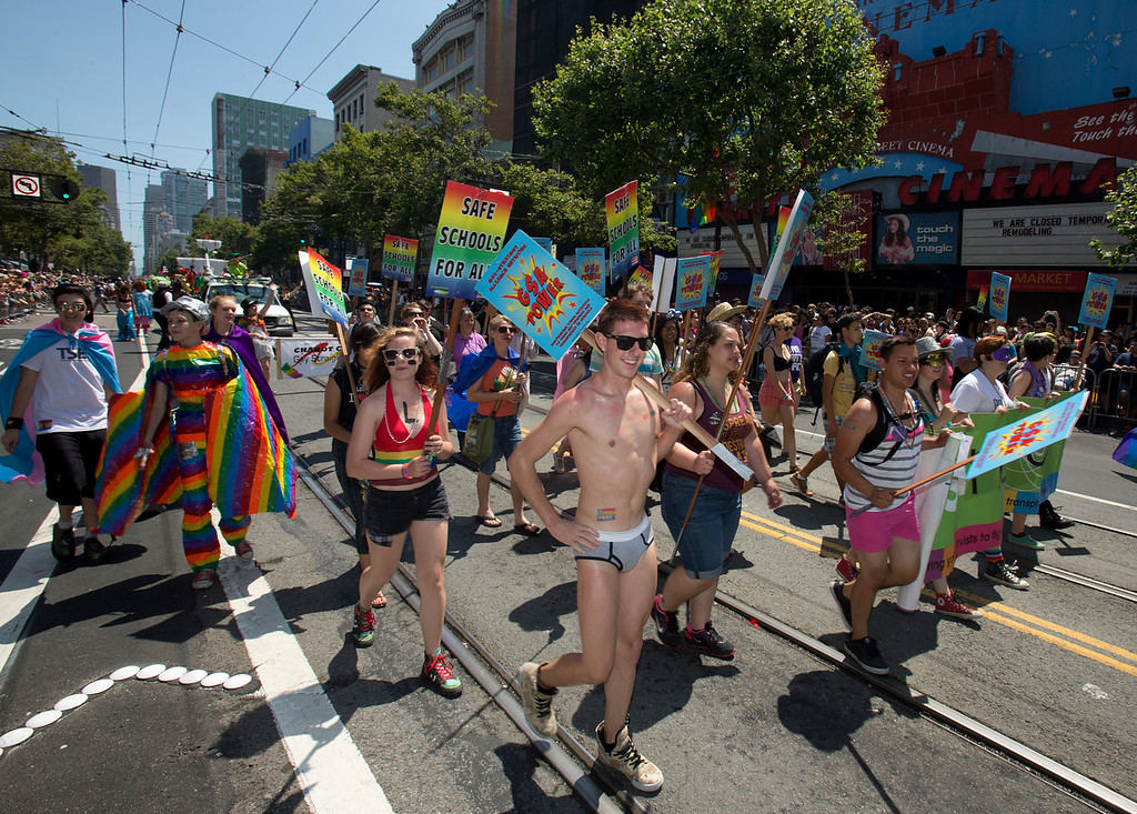 . Participants in the 43rd annual San Francisco Pride Parade march along Market Street, Sunday, June 30, 2013, in San Francisco, Calif. (D. Ross Cameron/Bay Area News Group)