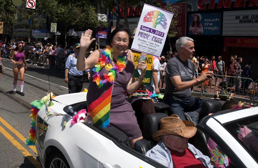 . Oakland Mayor Jean Quan, left, waves from the back of a convertible at the 43rd annual San Francisco Pride Parade, Sunday, June 30, 2013, in San Francisco, Calif. (D. Ross Cameron/Bay Area News Group)