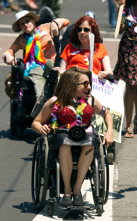 . Disabled members of the LGBT community roll their wheelchairs along Market Street at the 43rd annual San Francisco Pride Parade, Sunday, June 30, 2013, in San Francisco, Calif. (D. Ross Cameron/Bay Area News Group)