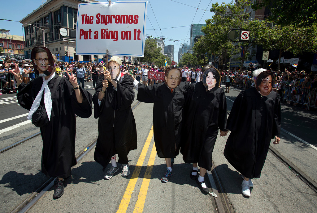 . Five unidentified women celebrate the U.S. Supreme Court\'s ruling earlier this week that allowed same-sex marriages to move forward in California, at the 43rd annual San Francisco Pride Parade, Sunday, June 30, 2013, in San Francisco, Calif. (D. Ross Cameron/Bay Area News Group)