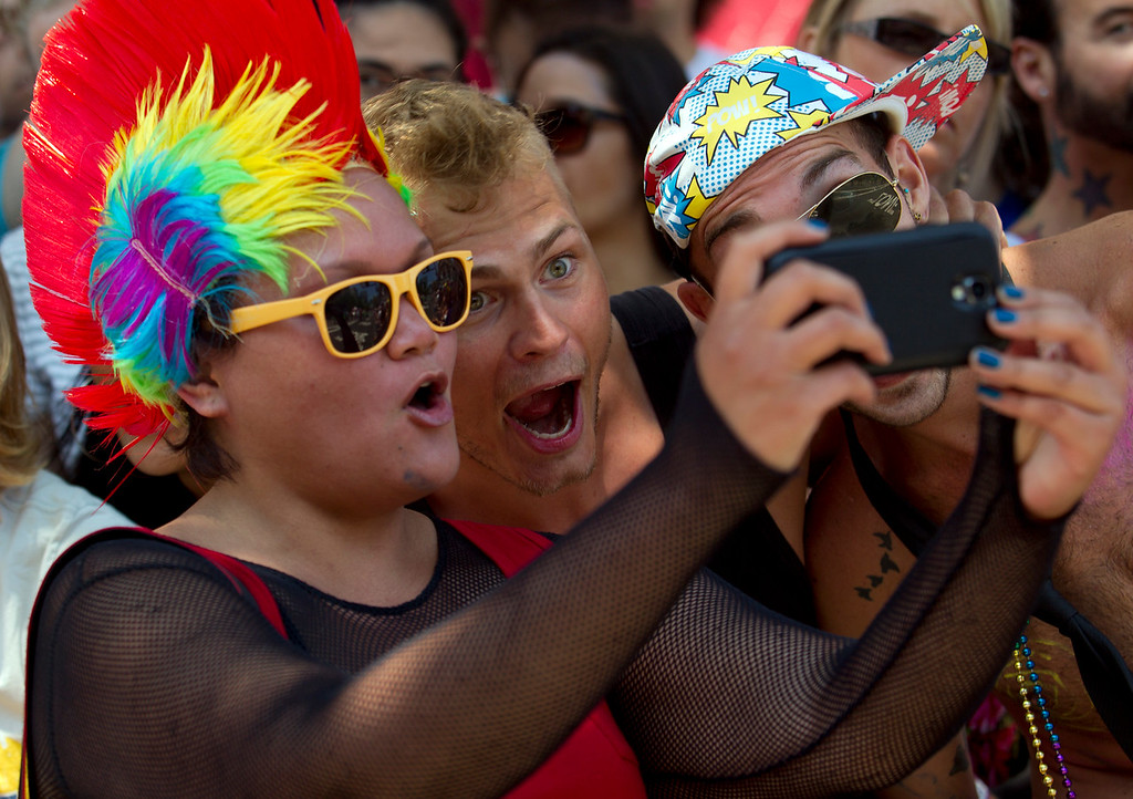 . Participants and spectators pose together for a cameraphone self-portrait at the 43rd annual San Francisco Pride Parade, Sunday, June 30, 2013, in San Francisco, Calif. (D. Ross Cameron/Bay Area News Group)