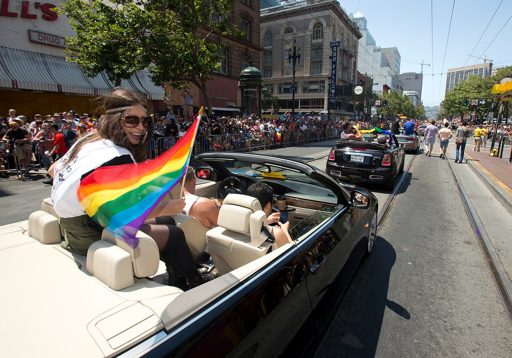 . A procession of convertible cars carries VIPs along Market Street at the 43rd annual San Francisco Pride Parade, Sunday, June 30, 2013, in San Francisco, Calif. (D. Ross Cameron/Bay Area News Group)