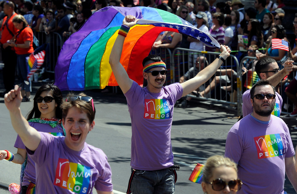. Folks line the street at the 42nd San Francisco Pride Celebration and Parade as it travels along Market Street in San Francisco, Calif., on Sunday, June 30, 2013. (Susan Tripp Pollard/Bay Area News Group)