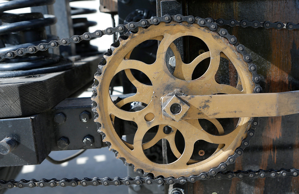 ". Chains and sprockets help drive the ""Black Bird,\"" a 48-volt electrically assisted bike, in San Jose, Calif., on Sunday, March 9, 2014. Dublin Lord Mayor Oisín Quinn joined cyclists on a seven-mile bicycle ride through the city as part of San Jose-Dublin Sister City Program festivities. Quinn is known for having championed the effort to create a bike sharing service in Dublin much akin to the similar service that\'s sprang up in San Jose and other Bay area cities. (Jim Gensheimer/Bay Area News Group)"