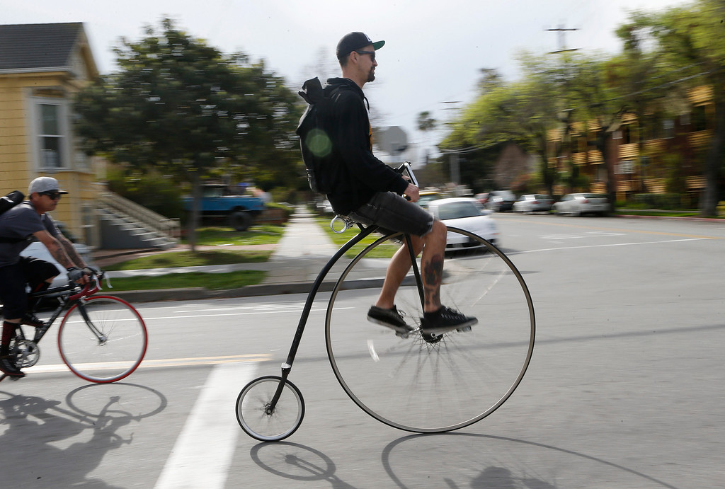 . Marcos Hidalgo, of San Jose, rides a penny-farthing during a bike ride in San Jose, Calif., on Sunday, March 9, 2014. Dublin Lord Mayor Oisín Quinn joined cyclists on a seven-mile bicycle ride through the city as part of San Jose-Dublin Sister City Program festivities. Quinn is known for having championed the effort to create a bike sharing service in Dublin much akin to the similar service that\'s sprang up in San Jose and other Bay area cities. (Jim Gensheimer/Bay Area News Group)