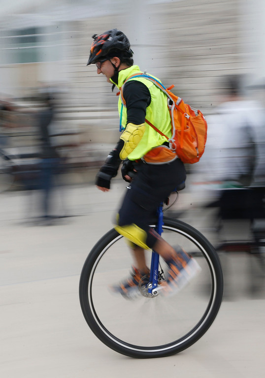 . Nader Sharifi, of San Jose, rides a unicycle during a bike ride in San Jose, Calif., on Sunday, March 9, 2014. Dublin Lord Mayor Oisín Quinn joined cyclists on a seven-mile bicycle ride through the city as part of San Jose-Dublin Sister City Program festivities. Quinn is known for having championed the effort to create a bike sharing service in Dublin much akin to the similar service that\'s sprang up in San Jose and other Bay area cities. (Jim Gensheimer/Bay Area News Group)