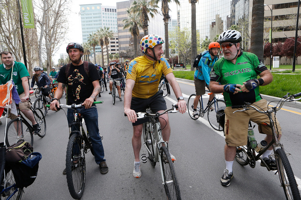 . Dublin Lord Mayor Oisín Quinn, center, talks to Jim Reber, of San Jose, during a bike ride in San Jose, Calif., on Sunday, March 9, 2014. Quinn joined cyclists on a seven-mile bicycle ride through the city as part of San Jose-Dublin Sister City Program festivities. Quinn is known for having championed the effort to create a bike sharing service in Dublin much akin to the similar service that\'s sprang up in San Jose and other Bay area cities. (Jim Gensheimer/Bay Area News Group)