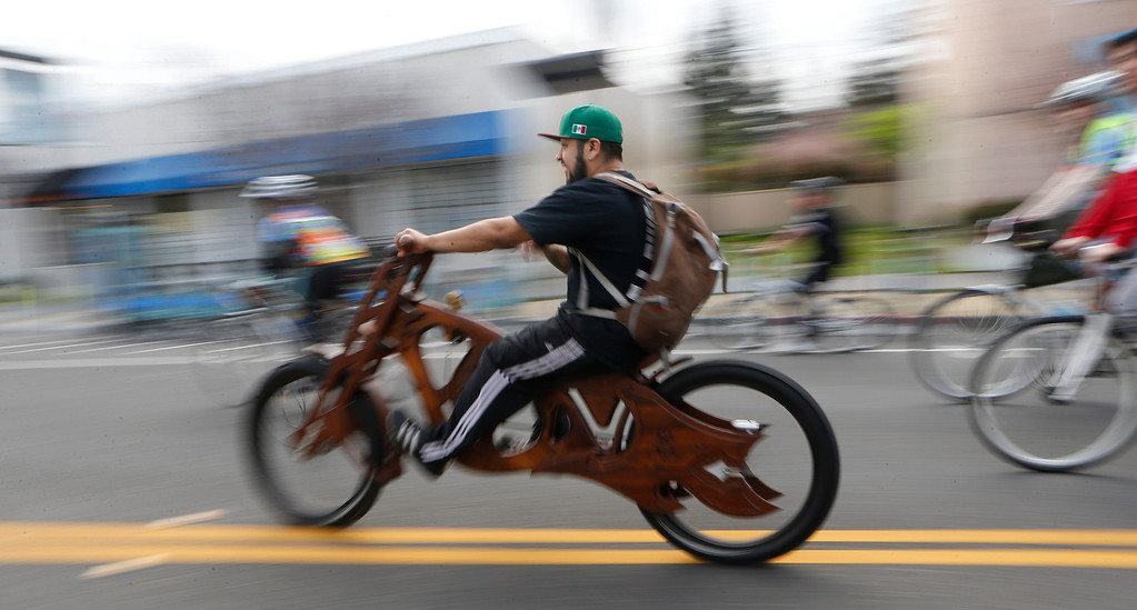 ". Mauro Hernandez, of San Jose, rides the wood-framed  ""Interceptor\"" he built at Masterworks during a bike ride in San Jose, Calif., on Sunday, March 9, 2014. Dublin Lord Mayor Oisín Quinn joined cyclists on a seven-mile bicycle ride through the city as part of San Jose-Dublin Sister City Program festivities. Quinn is known for having championed the effort to create a bike sharing service in Dublin much akin to the similar service that\'s sprang up in San Jose and other Bay area cities. (Jim Gensheimer/Bay Area News Group)"