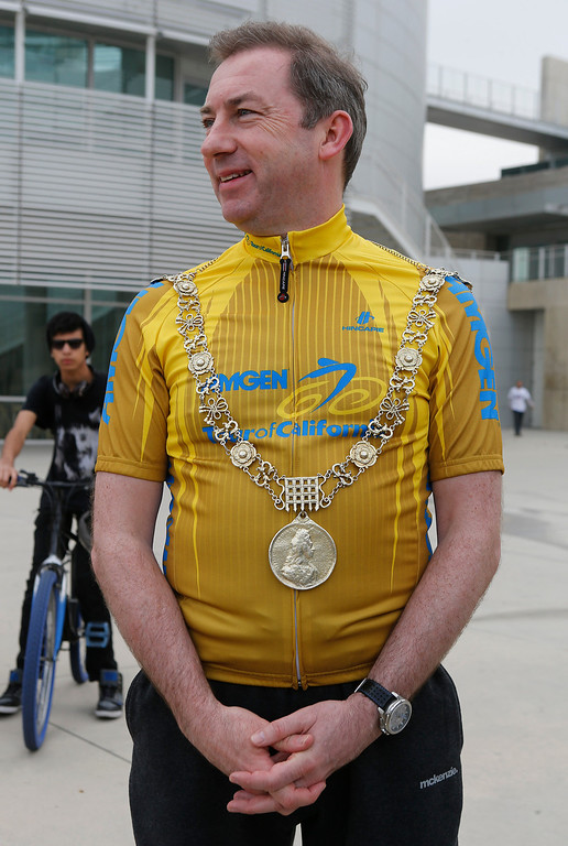. Wearing the gold chain of office, Dublin Lord Mayor Oisín Quinn waits to address participants before a bicycle ride in San Jose, Calif., on Sunday, March 9, 2014. Quinn joined cyclists on a seven-mile bicycle ride through the city as part of San Jose-Dublin Sister City Program festivities. Quinn is known for having championed the effort to create a bike sharing service in Dublin much akin to the similar service that\'s sprang up in San Jose and other Bay area cities. (Jim Gensheimer/Bay Area News Group)