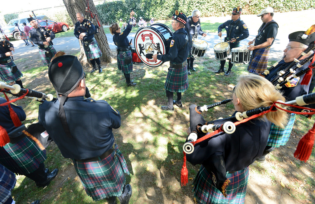 . Members of the Cal Fire Firefighters Pipes & Drums Band practice during the 148th annual Scottish Highland Gathering and Games held at the Alameda County Fairgrounds in Pleasanton, Calif., on Saturday, Aug. 13, 2013. The Scottish Highland Gathering and Games continues on Sunday. (Doug Duran/Bay Area News Group)