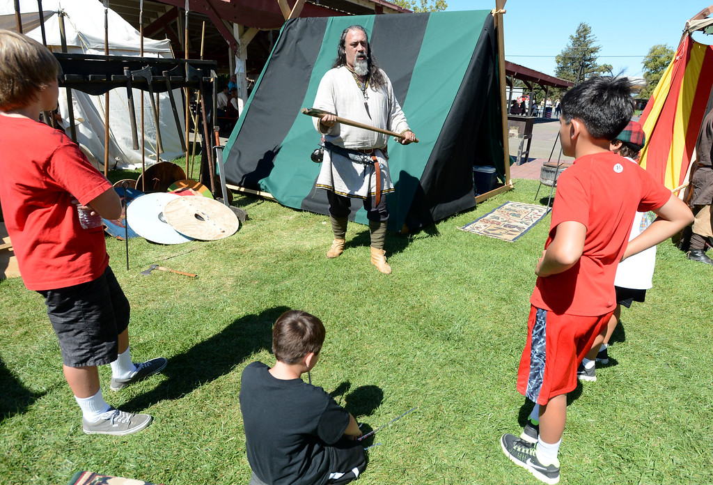 ". Dark Boar Vikings member Denis Carpena, of Gilroy, with the Viking name ""Kjarden\"" demonstrates how a battle ax is used during the 148th annual Scottish Highland Gathering and Games held at the Alameda County Fairgrounds in Pleasanton, Calif., on Saturday, Aug. 13, 2013. The Scottish Highland Gathering and Games continues on Sunday. (Doug Duran/Bay Area News Group)"