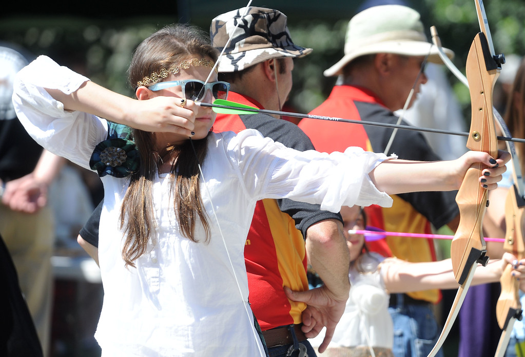 . Dominique Sullivan, 12, of Redwood City, takes aim at the Predator\'s Archery area  during the 148th annual Scottish Highland Gathering and Games held at the Alameda County Fairgrounds in Pleasanton, Calif., on Saturday, Aug. 13, 2013. People could test their skills at the Archery area under the supervision of experts. The Scottish Highland Gathering and Games continues on Sunday. (Doug Duran/Bay Area News Group)