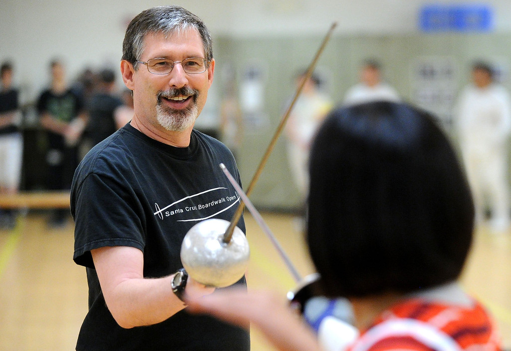 . Fencing instructor Stephen Murray, of Livermore, leads a training session during the Las Positas Fencing Center\'s Level II/III Foil & Epee for adults class held at Las Positas College in Livermore, Calif., on Tuesday, July 9, 2013. The fencing center is operated through the Las Positas College Community Education program and offers instruction in foil, epee and saber. The center offers classes in all levels of fencing for adults and children over the age of 8. (Doug Duran/Bay Area News Group)