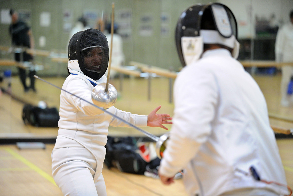 . Joy Silvestre, of Union City, left, has a fencing match with a classmate using an epee dueling sword during the Las Positas Fencing Center\'s class for adults held at Las Positas College in Livermore, Calif., on Tuesday, July 9, 2013. The fencing center is operated through the Las Positas College Community Education program and offers instruction in foil, epee and saber. The center offers classes in all levels of fencing for adults and children over the age of 8. (Doug Duran/Bay Area News Group)