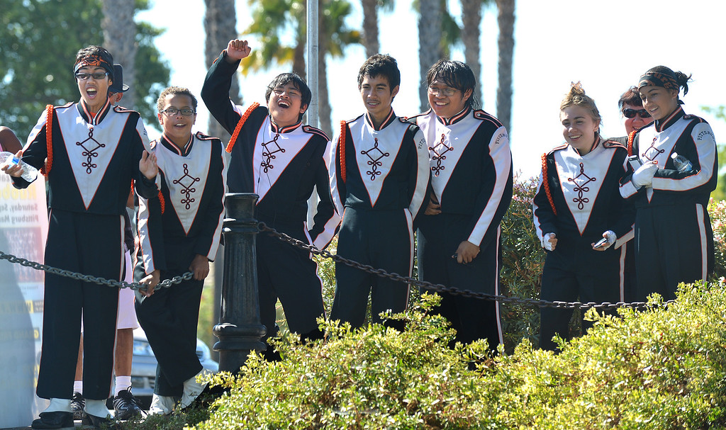 . Members of the Pittsburg High Marching Show Band yell out as their duck wins the main race during the yellow duck races at the Pittsburg Marina in Pittsburg, Calif., on Saturday, Sept. 28, 2013. The races benefit the Pittsburg Marching Show Band, which is trying to raise money so they can participate in the New Year\'s Day parade in London. (Dan Rosenstrauch/Bay Area News Group)