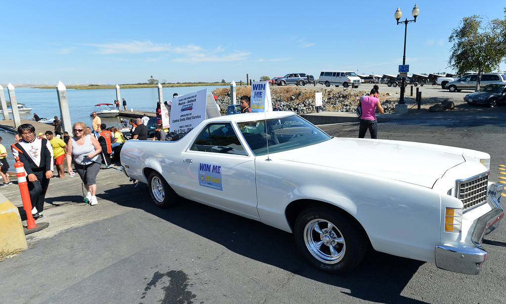 . A restored 1979 Grand Ranchero was won by the Pittsburg High Marching Show Band during the yellow duck races at the Pittsburg Marina in Pittsburg, Calif., on Saturday, Sept. 28, 2013. The races benefit the Pittsburg Marching Show Band, which is trying to raise money so they can participate in the New Year\'s Day parade in London. (Dan Rosenstrauch/Bay Area News Group)