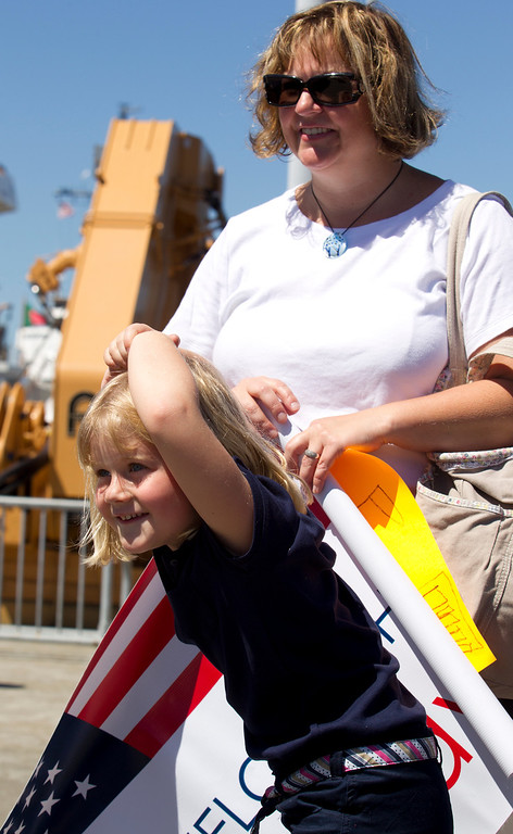 . Melinda Sundland, right, and her daughter, Maryn, look for Executive Officer Joe Sundland as they wait on the pier for the return of the USCG Cutter Bertholf on Thursday, Sept. 5, 2013, on Coast Guard Island in Alameda, Calif. The crew of more than 100 seamen returned from a 160-day deployment to the eastern Pacific Ocean. (D. Ross Cameron/Bay Area News Group)