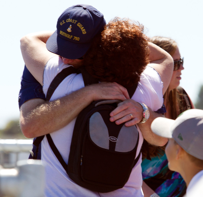. There were hugs and kisses aplenty as families and friends welcomed home the crew of the USCG Cutter Bertholf on Thursday, Sept. 5, 2013, on Coast Guard Island in Alameda, Calif. The crew of more than 100 seamen returned from a 160-day deployment to the eastern Pacific Ocean. (D. Ross Cameron/Bay Area News Group)