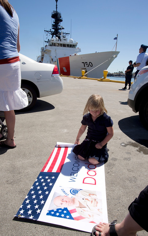 . Maryn Sundland, daughter of USCG Cutter Bertholf Executive Officer Joe Sundland, waits patiently for her father to debark on Thursday, Sept. 5, 2013, on Coast Guard Island in Alameda, Calif. The crew of more than 100 seamen returned from a 160-day deployment to the eastern Pacific Ocean. (D. Ross Cameron/Bay Area News Group)