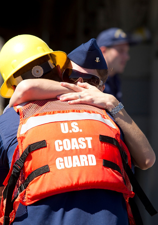 . Boatswain\'s Mate Jesse Kassbaum, left, gets a warm welcome home from wife Courtney aboard the USCG Cutter Bertholf on Thursday, Sept. 5, 2013 on Coast Guard Island in Alameda, Calif. The crew of more than 100 seamen returned from a 160-day deployment to the eastern Pacific Ocean. (D. Ross Cameron/Bay Area News Group)
