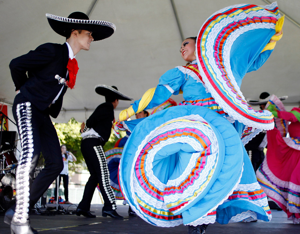 . Denise Ramos, 19, and Jaime Jimenez, 17, members of Ballet Folklorico Mexicano de Carlos Moreno of Oakland perform at the ¡VivaFest!/El Grito music and cultural festival celebrating Mexico�s Independence Day at Discovery Meadow in San Jose, Calif., on Sunday, Sept. 15, 2013. (Josie Lepe/Bay Area News Group)