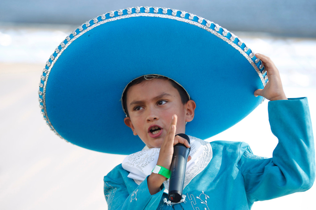 . Belmont resident Daniel Ordoñez, 8, sings on stage at the ¡VivaFest!/El Grito music and cultural festival celebrating Mexico�s Independence Day at Discovery Meadow in San Jose, Calif., on Sunday, Sept. 15, 2013. Daniel, a special guest singer, was a contestant of the Factor X on Mundo Fox 38. (Josie Lepe/Bay Area News Group)