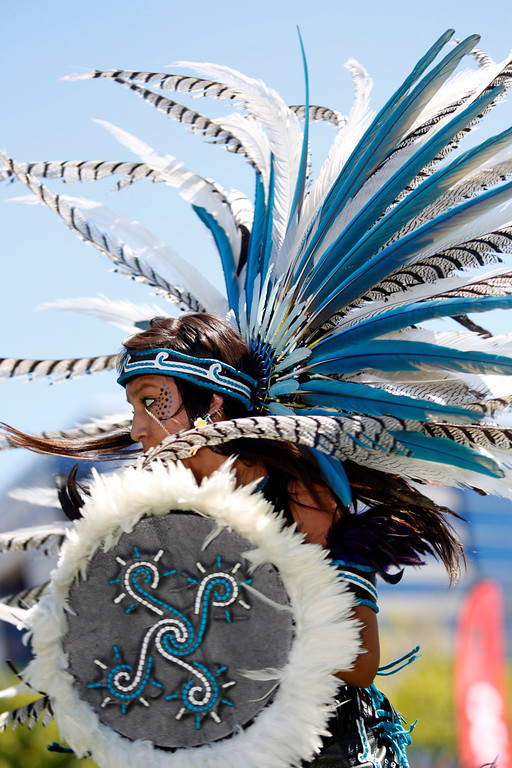 """. Abigail Del Carmen, 18, a \""""Cuauyohua\"""" member of Aztec dance group Calpulli Tonalehqueh from the School of Arts and Culture, performs during the ¡VivaFest!/El Grito music and cultural festival celebrating Mexico�s Independence Day at Discovery Meadow in San Jose, Calif., on Sunday, Sept. 15, 2013. (Josie Lepe/Bay Area News Group)"""