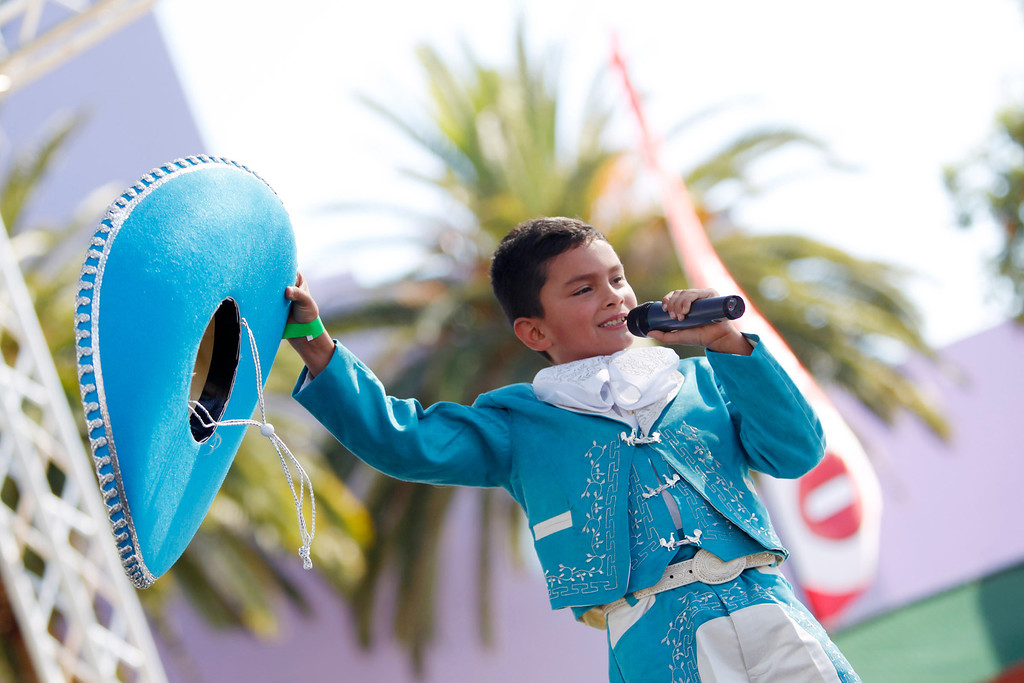 . Belmont resident Daniel Ordoñez, 8, sings on stage at the ¡VivaFest!/El Grito music and cultural festival celebrating Mexico�s Independence Day at Discovery Meadow in San Jose, Calif., on Sunday, Sept. 15, 2013. Daniel was a contestant of the Factor X on Mundo Fox 38. (Josie Lepe/Bay Area News Group)