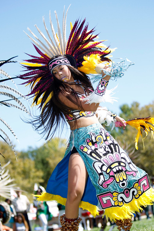 . Alexis Rosas, 13, a member of Aztec dance group Calpulli Tonalehqueh from the School of Arts and Culture, performs during the ¡VivaFest!/El Grito music and cultural festival celebrating Mexico�s Independence Day at Discovery Meadow in San Jose, Calif., on Sunday, Sept. 15, 2013. (Josie Lepe/Bay Area News Group)