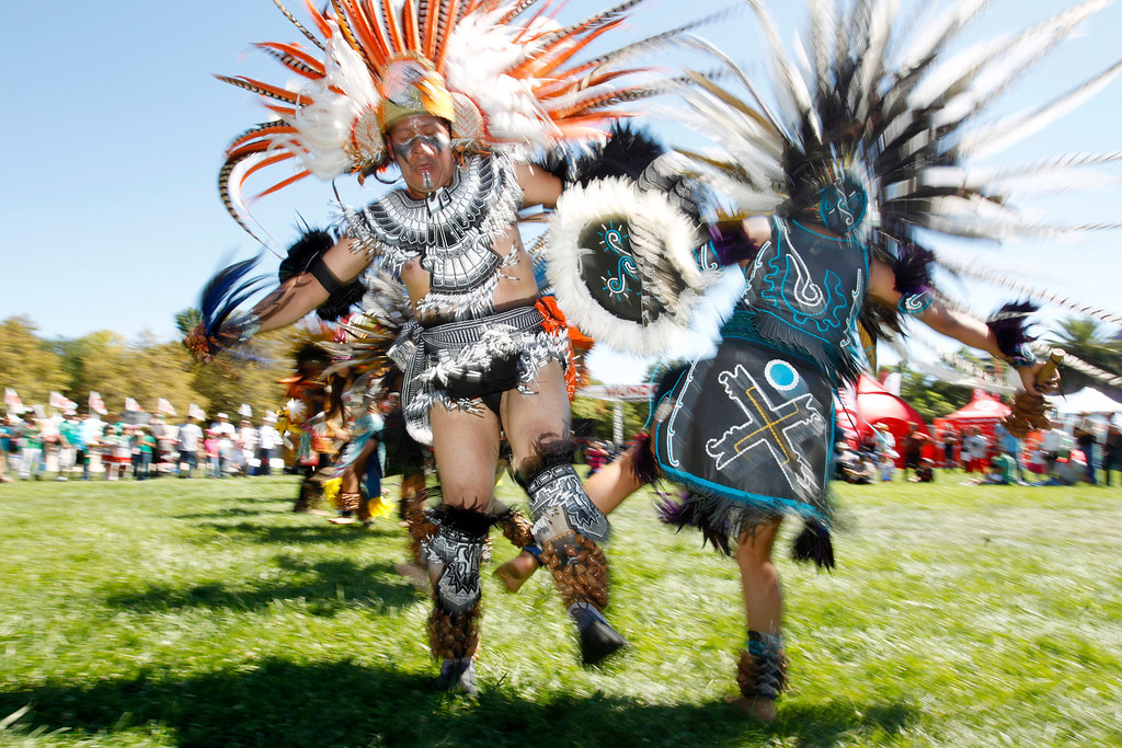 """. Raul Torres and  Abigail Del Carmen, 18, \""""Cuauyohua\"""" members of Aztec dance group Calpulli Tonalehqueh from the School of Arts and Culture, perform during the ¡VivaFest!/El Grito music and cultural festival celebrating Mexico�s Independence Day at Discovery Meadow in San Jose, Calif., on Sunday, Sept. 15, 2013. (Josie Lepe/Bay Area News Group)"""