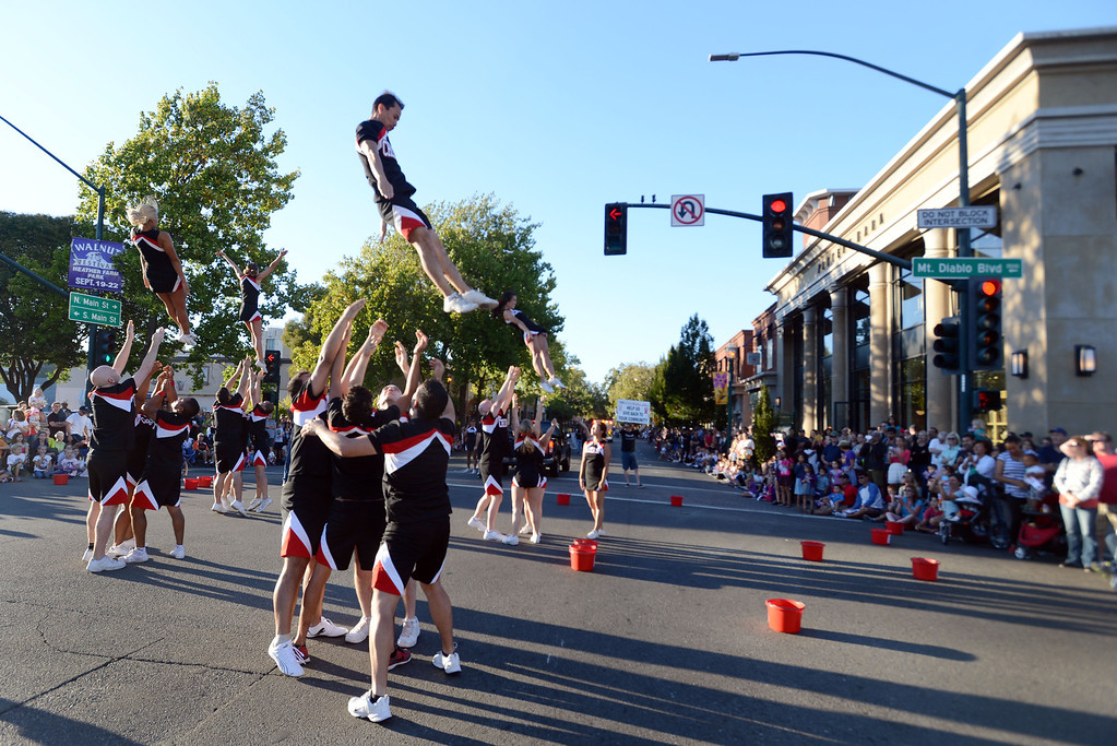 . Members of Cheer SF perform along Main Street during the Walnut Festival Twilight Parade in Walnut Creek, Calif., on Saturday, Sept. 14, 2013.  (Susan Tripp Pollard/Bay Area News Group)