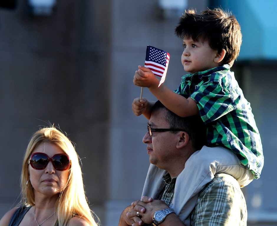 . A young boys gets a shoulder top view point at the Walnut Festival Twilight Parade in Walnut Creek, Calif., on Saturday, Sept. 14, 2013.  (Susan Tripp Pollard/Bay Area News Group)