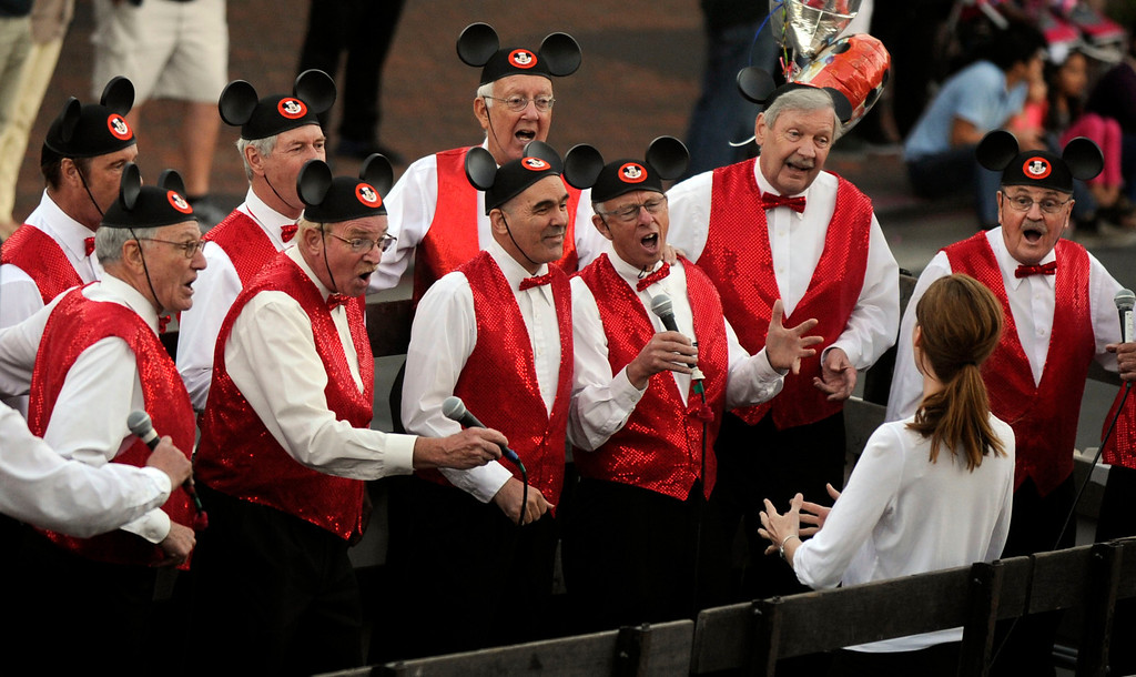 . Members of the Devil Mountain Mouseketeers perform on Main Street during the Walnut Festival Twilight Parade in Walnut Creek, Calif., on Saturday, Sept. 14, 2013.  (Susan Tripp Pollard/Bay Area News Group)