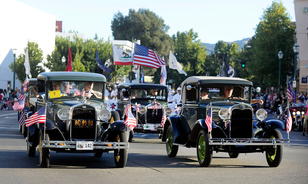 . Old classic cars roll down Main Street at the Walnut Festival Twilight Parade in Walnut Creek, Calif., on Saturday, Sept. 14, 2013.  (Susan Tripp Pollard/Bay Area News Group)