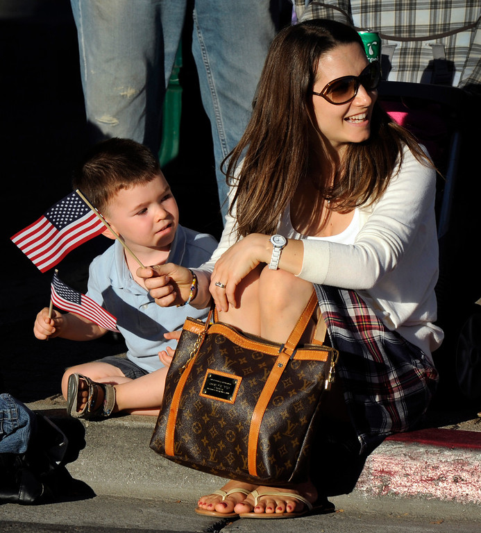 . Matthew Heath, 3, watches the entertainment go by along Main Street with his mother Ella Heath at the Walnut Festival Twilight Parade in Walnut Creek, Calif., on Saturday, Sept. 14, 2013.  (Susan Tripp Pollard/Bay Area News Group)