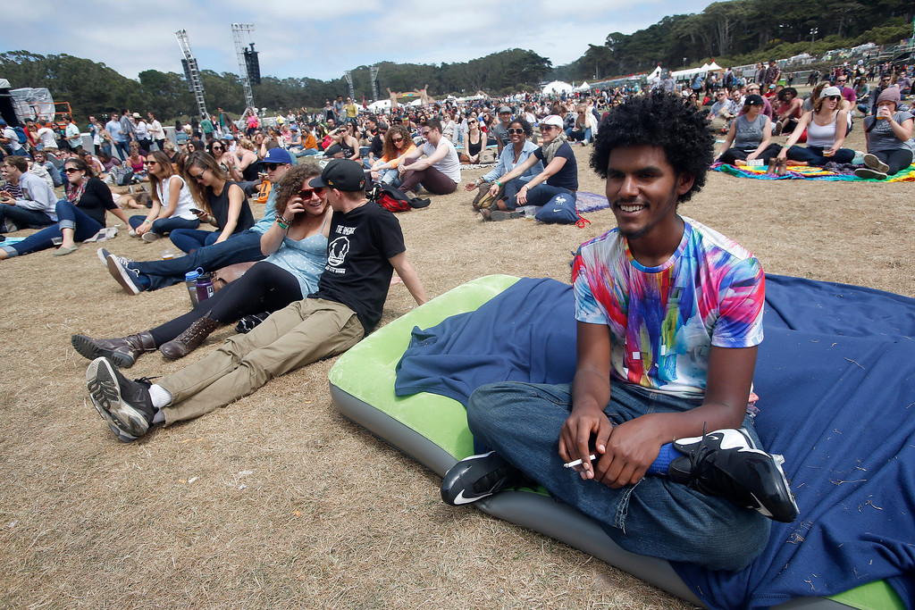 . Hugo Melo, from New York City, listens to bands on the Land\'s End stage during the last day of the Outside Lands music festival at Golden Gate Park in San Francisco, Calif., on Sunday, Aug. 10, 2014. (Jane Tyska/Bay Area News Group)
