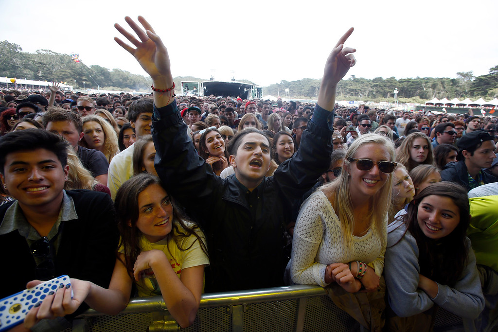 . Caanan Kramer, of Los Angeles, center, sings along during The Flaming Lips set on the Land\'s End stage during day three of the Outside Lands music festival at Golden Gate Park in San Francisco, Calif., on Sunday, Aug. 10, 2014. (Jane Tyska/Bay Area News Group)