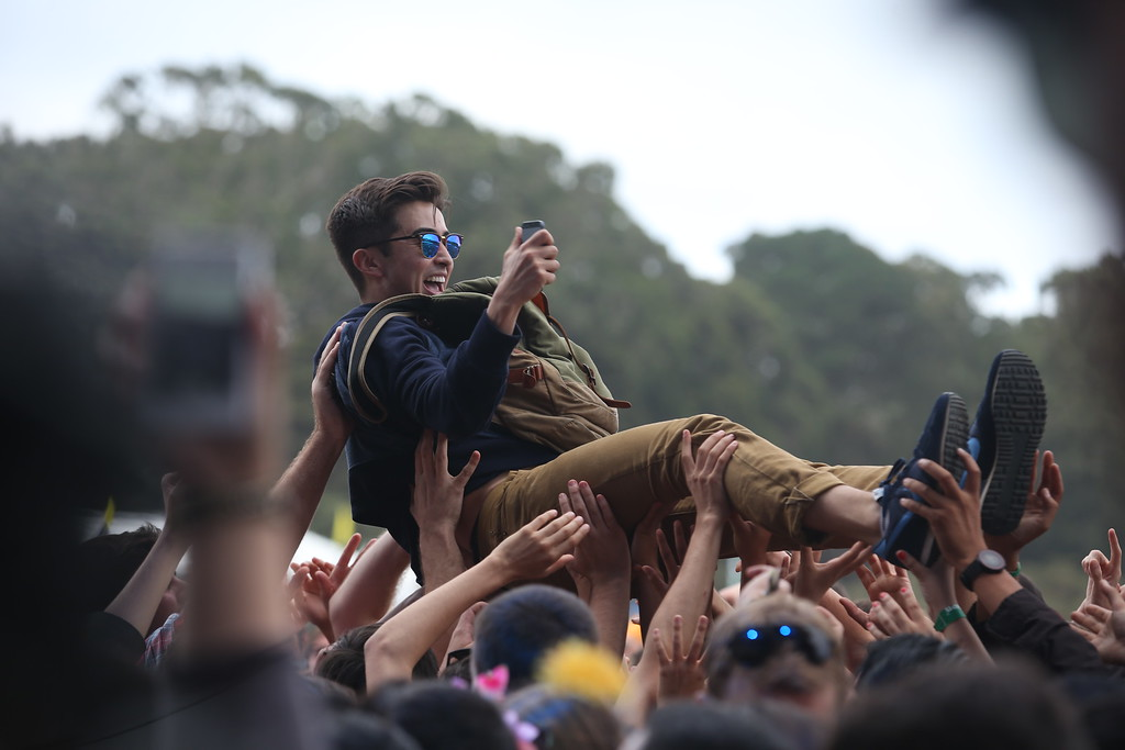 . A concertgoer crowd surfs while The Flaming Lips perform on the Land\'s End stage during the last day of the Outside Lands music festival at Golden Gate Park in San Francisco, Calif., on Sunday, Aug. 10, 2014. (Jane Tyska/Bay Area News Group)