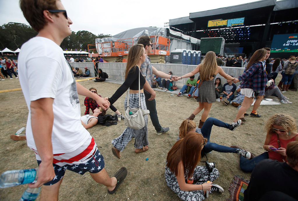 . Concertgoers head towards the Land\'s End stage during the last day of the Outside Lands music festival at Golden Gate Park in San Francisco, Calif., on Sunday, Aug. 10, 2014. (Jane Tyska/Bay Area News Group)
