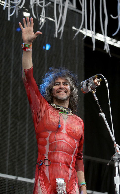 . The Flaming Lips lead singer Wayne Coyne greets the crowd as they perform on the Land\'s End stage during day three of the Outside Lands music festival at Golden Gate Park in San Francisco, Calif., on Sunday, Aug. 10, 2014. (Jane Tyska/Bay Area News Group)