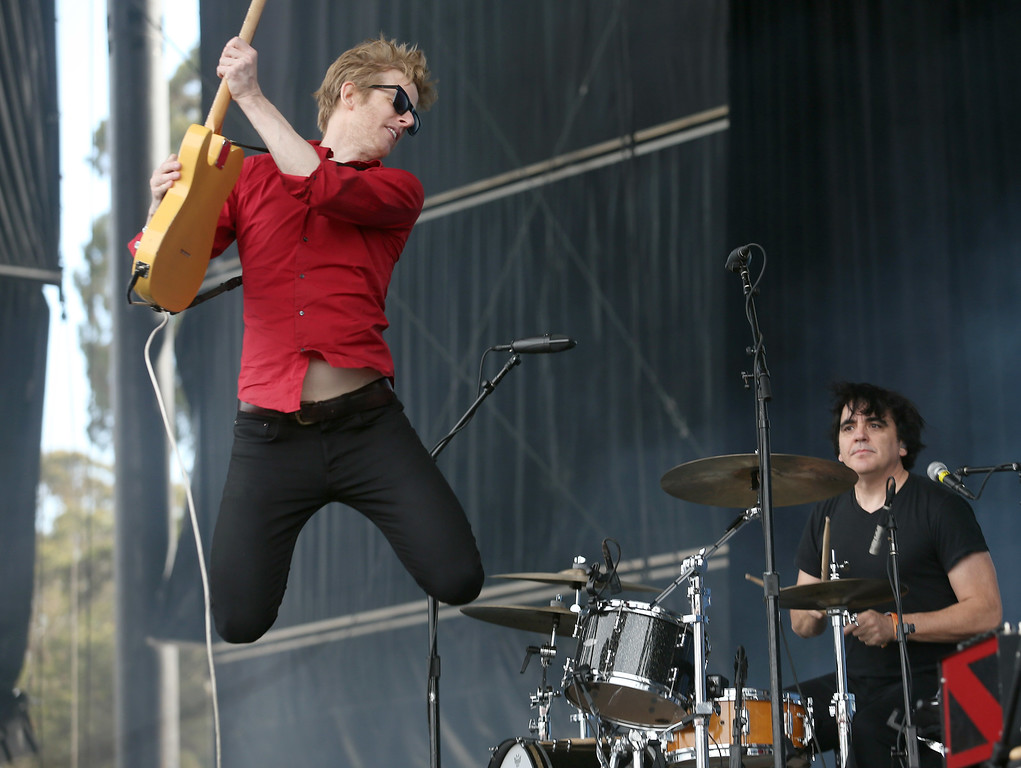 . Spoon lead singer Britt Daniel leaps while performing on the Land\'s End stage during day three of the Outside Lands music festival at Golden Gate Park in San Francisco, Calif., on Sunday, Aug. 10, 2014. (Jane Tyska/Bay Area News Group)